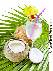 Coconut water. - Coconut water in glass served on palm leaf...