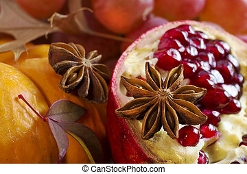 Star anise. - Orange pumpkin, star anise and pomegranate...