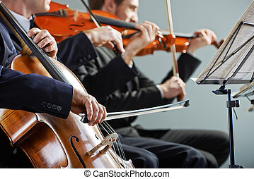 Classical music: concert - Cellist and violinist playing at...