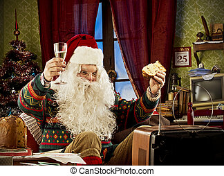 Santa Claus - Portrait of Santa Claus watching tv,...