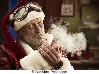 Bad Santa smoking a joint - Portrait of a frowning Bad Santa...