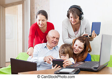 people uses few various electronic devices - Group of people...