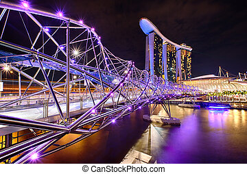 The Helix bridge with Marina Bay Sands in background,...