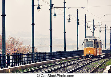 Tram in Budapest - Yellow tram in Budapest, Hungary. Early...