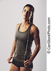 Beautiful young woman with a jump rope - Portrait of...