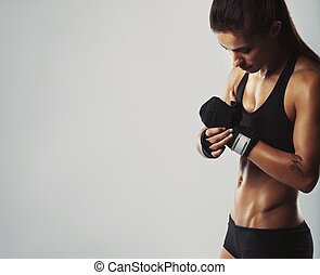 Young woman getting ready for workout - Female bodybuilder...