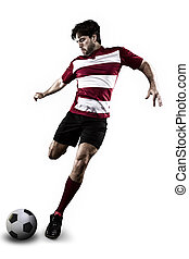 Soccer player in a red uniform kicking. White Background
