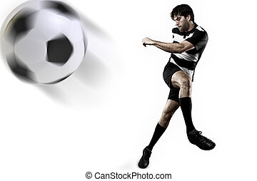 Soccer player in a Black uniform kicking. White Background