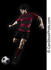Soccer player in a red and black uniform kicking. Black...