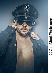 Sexy police concept, dangerous man with sunglasses