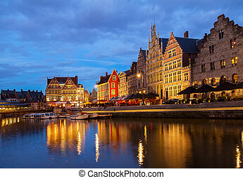 Graslei harbor, Ghent - Exterior of illuminated buildings on...