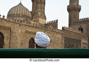 Blue turban - Old men in front of a mosque beside AlKhan...