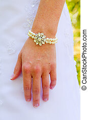 Bridal Bracelet Pearl Jewelry - Bride hand and wrist with a...