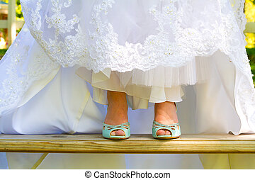 Bride Wearing Wedding Shoes - Blue wedding shoes shown to...