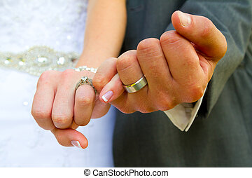 Pinky Swear Wedding Rings - Bride and groom with their hands...
