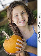 Pretty Young Girl Having Fun with the Pumpkins at Market -...