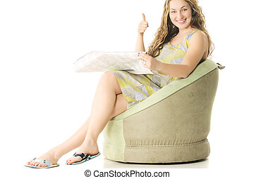 Good news - Young woman with newspaper gesturing thumb up