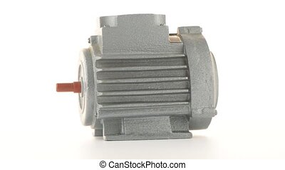 Electric motor rotating on white background.