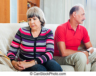 Senior couple after quarrel - Senior couple after quarrel in...