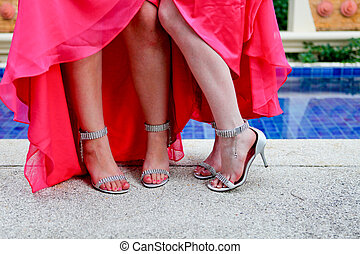 Bridesmaids shoes. - Close-up of bridesmaids by the swimming...
