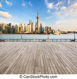 modern cityscape in shanghai,city skyline with wooden floor...