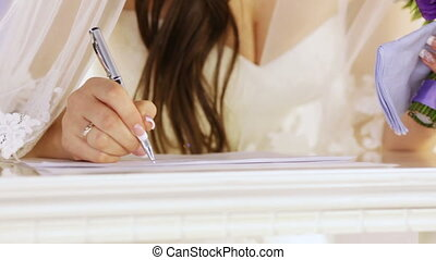Signature in the marriage contract - The bride signs the...