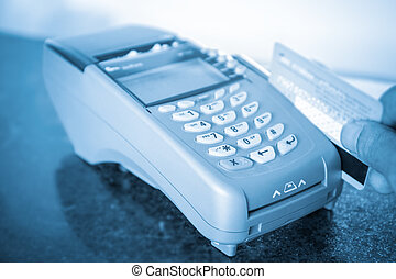 closeup of payment machine - payment on a credit card...