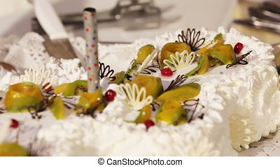 Wedding cake - A groom and fiancee cut a wedding cake and...