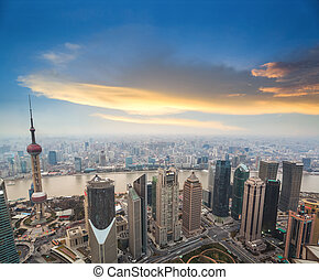 aerial view of shanghai at dusk with sunset glow