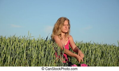 woman lies corn field - happy woman lies down between the...