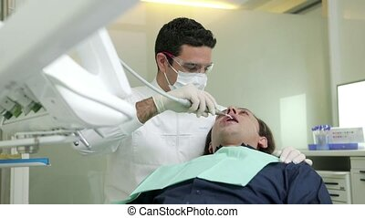 Dentist visiting patient - Portrait of happy hispanic man...