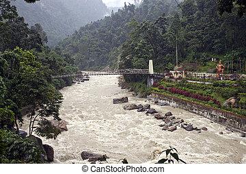 Suspension bridge over a river, Sikkim, India