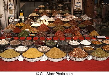 Indian Market Stall - Bowls of nuts, pulses and spices on a...
