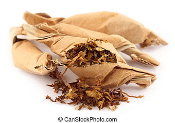 Tobacco in twisted paper over white background