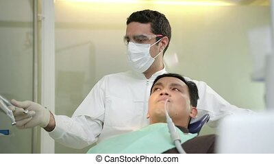 Dentist visiting patient - Doctor working as dentist,...