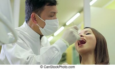 12of19 Dentist visiting patient - Portrait of happy asian...