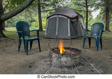 Camping Fire and tent - Pitched tent, crackling campfire,...