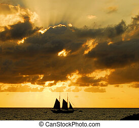 Sunset Sails - Sailing at sunset near St Maarten in the...