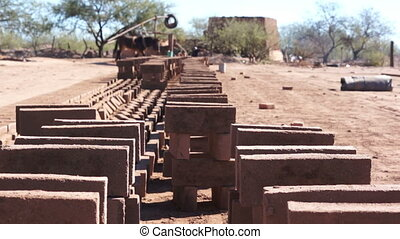 Adobe Brick Manufacturing Dolly - Long, dolly shot of a row...