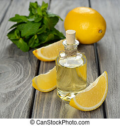Lemon essential oil on a gray background