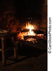 fire in the old stone fireplace
