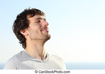 Close up of a man doing breath exercises outdoor with the...
