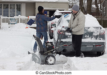Snow Removal - Father and sons clearing snow after storm