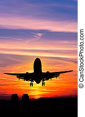 Plane and sunset - Concept or conceptual black plane,...