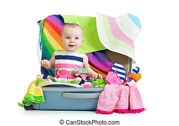 Kid girl sitting in suitcase with clothes for vacation travel