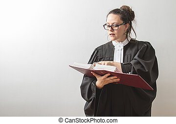 Reciting the law - thirty something brunette woman wearing a...