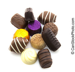 Assortment of fine chocolates in white, dark, and milk on a...