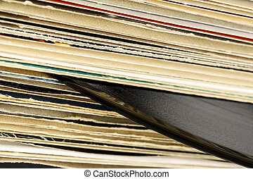 Stack of vinyl records in covers