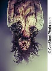 Male model hanging, evil, blind, fallen angel of death