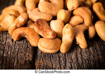 Cashew nuts - Close up to cashew nuts on the wooden table